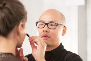 Daniel Martin lead makeup artist backstage at NYX Cosmetics Official Makeup Sponsor of Nicholas K Spring/Summer 2014 at Lincoln Center in New York City.