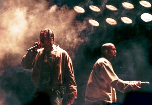 Travis Scott performs with Kanye West at FYF Fest 2015 at LA Sports Arena & Exposition Park in Los Angeles, California.