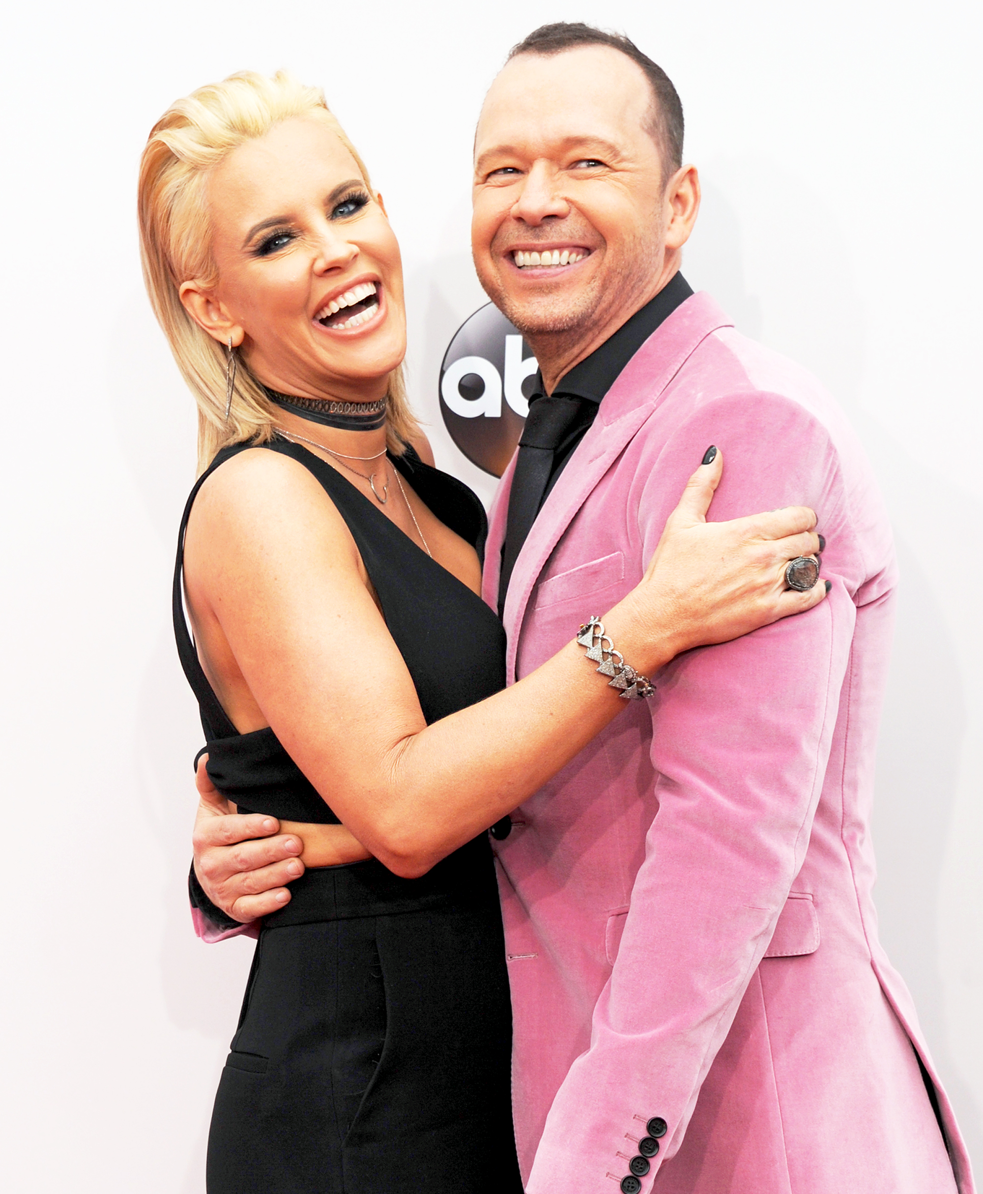 Jenny McCarthy and Donnie Wahlberg arrive at the 2016 American Music Awards at Microsoft Theater in Los Angeles, California.