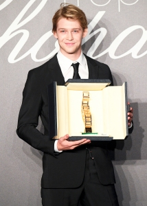 Joe Alwyn holds the throphy at Chopard Trophy photocall during the 71st annual Cannes Film Festival at Martinez Hotel on May 14, 2018 in Cannes, France.