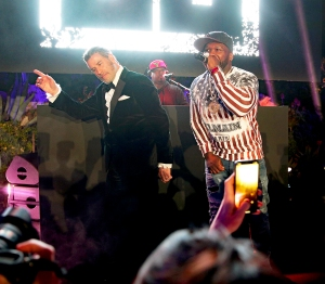 John Travolta and 50 Cent on stage during the party in Honour of John Travolta's receipt of the Inaugural Variety Cinema Icon Award during the 71st annual Cannes Film Festival on May 15, 2018 in Cap d'Antibes, France.