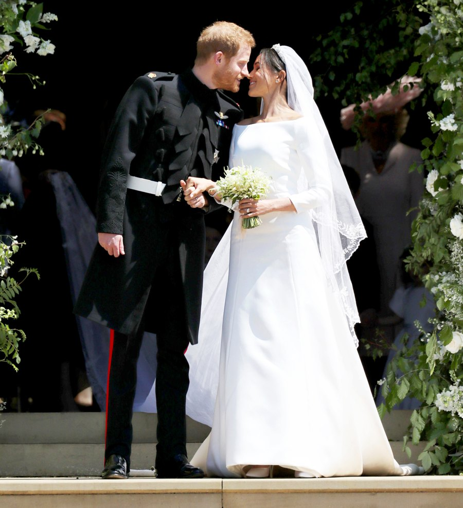 Prince Harry and Meghan Markle leave St George's Chapel after their wedding in St George's Chapel at Windsor Castle on May 19, 2018 in Windsor, England.