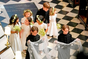 Bridesmaids and Page Boys, including John and Brian Mulroney, walk behind US actress Meghan Markle during her wedding to Britain's Prince Harry, Duke of Sussex in St George's Chapel, Windsor Castle on May 19, 2018.