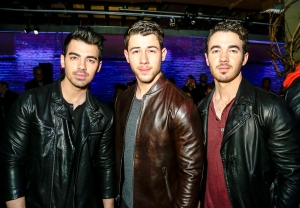 Joe Jonas, Nick Jonas and Kevin Jonas attend John Varvatos Fall/Winter 2018 Show at The Angel Orensanz Foundation in New York City.