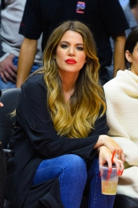 Khloe Kardashian attends a basketball game