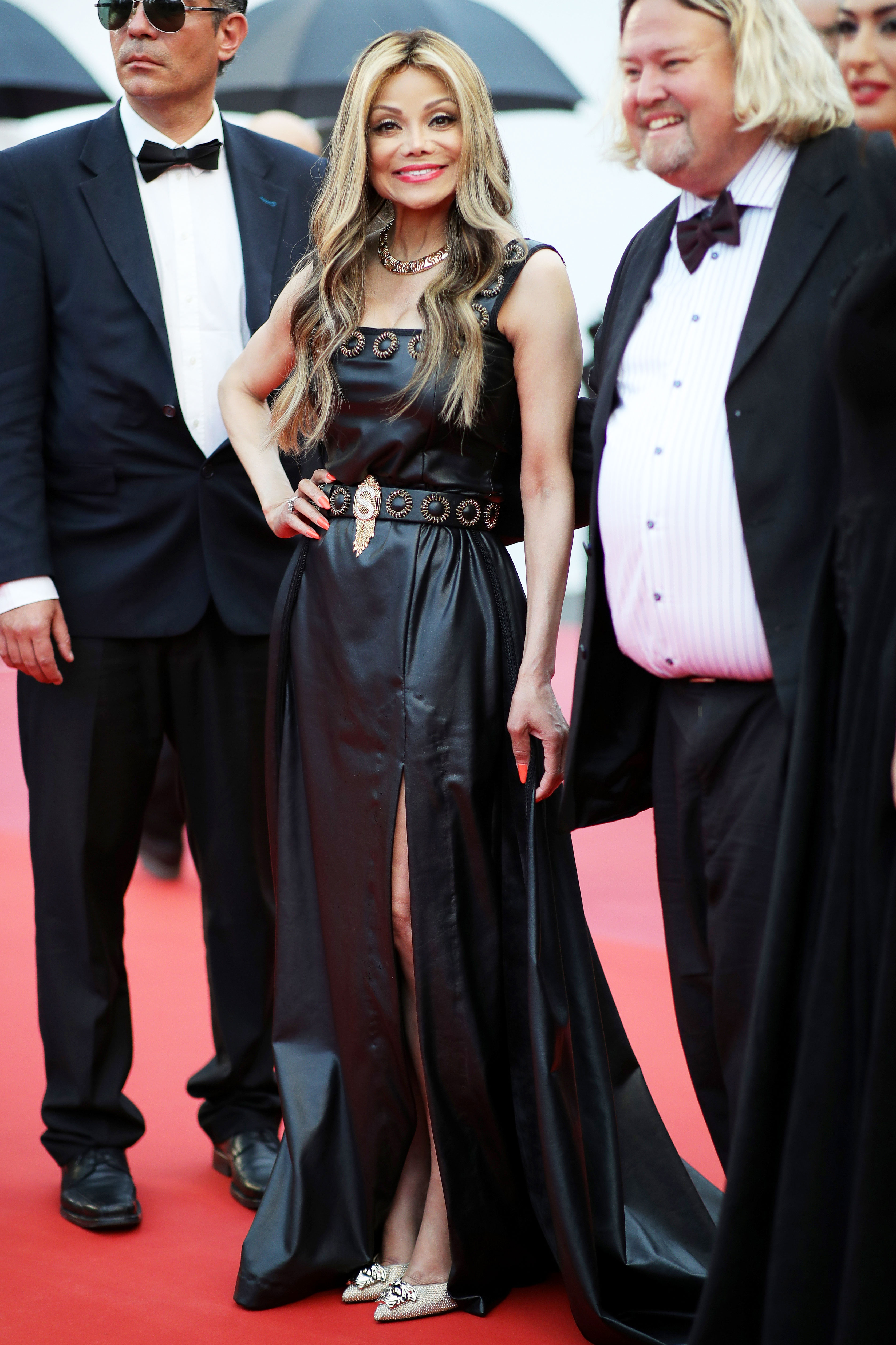 LA Toya Jackson - The 62-year-old songstress stole the show at the Burning screening on Wednesday, May 16, in a black leather gown with a thigh-high slit.
