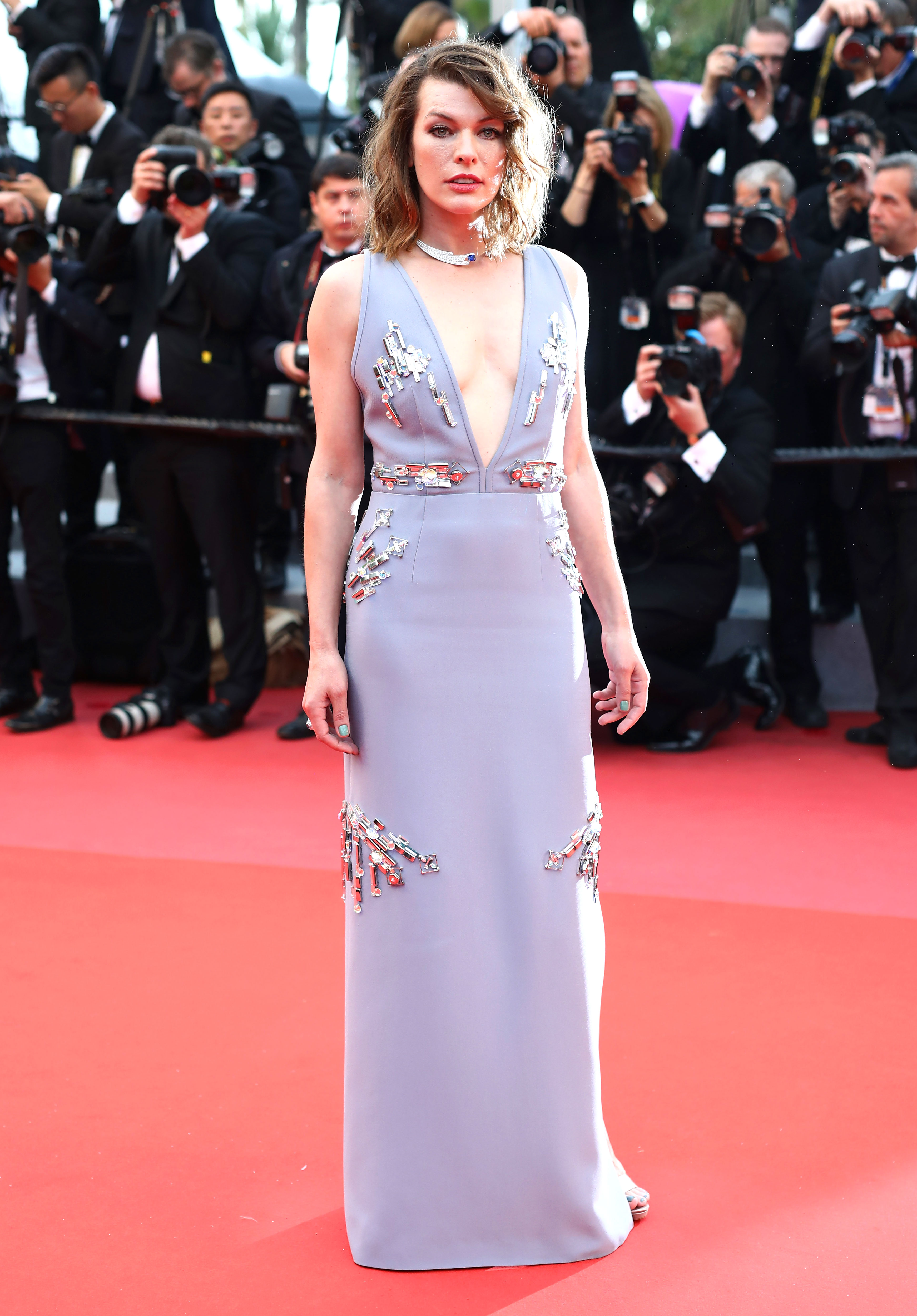 Milla Jovovich - At the Burning premiere on Wednesday, May 16, the actress sparkled in a periwinkle embellished Prada gown and Piaget jewels.