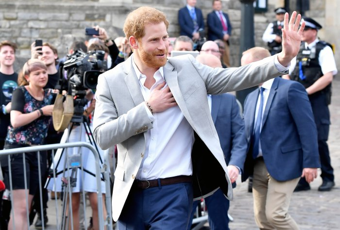 Prince Harry Greets Well Wishers Outside Windsor
