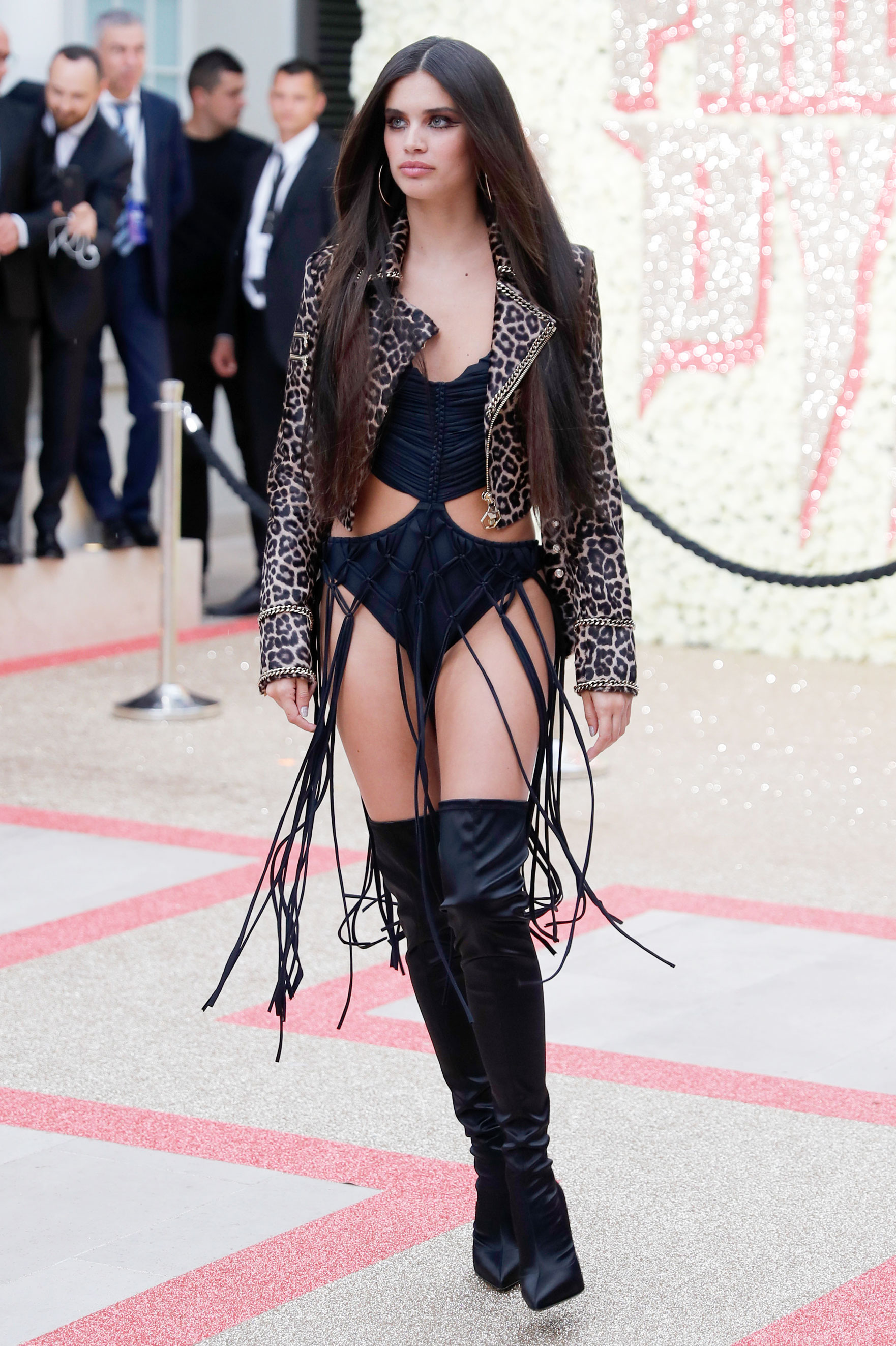 Sara Sampaio - We can thank the Victoria's Secret model, who rocked a tasseled bodysuit, leopard print bomber and thigh-high boots, for the summer beach inspiration at the Philipp Plein Resort 2019 fashion show on Wednesday, May 16.