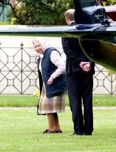 The Queen arrives at Kensington Palace by helicopter to meet Prince Louis for the first time on April 30, 2018.