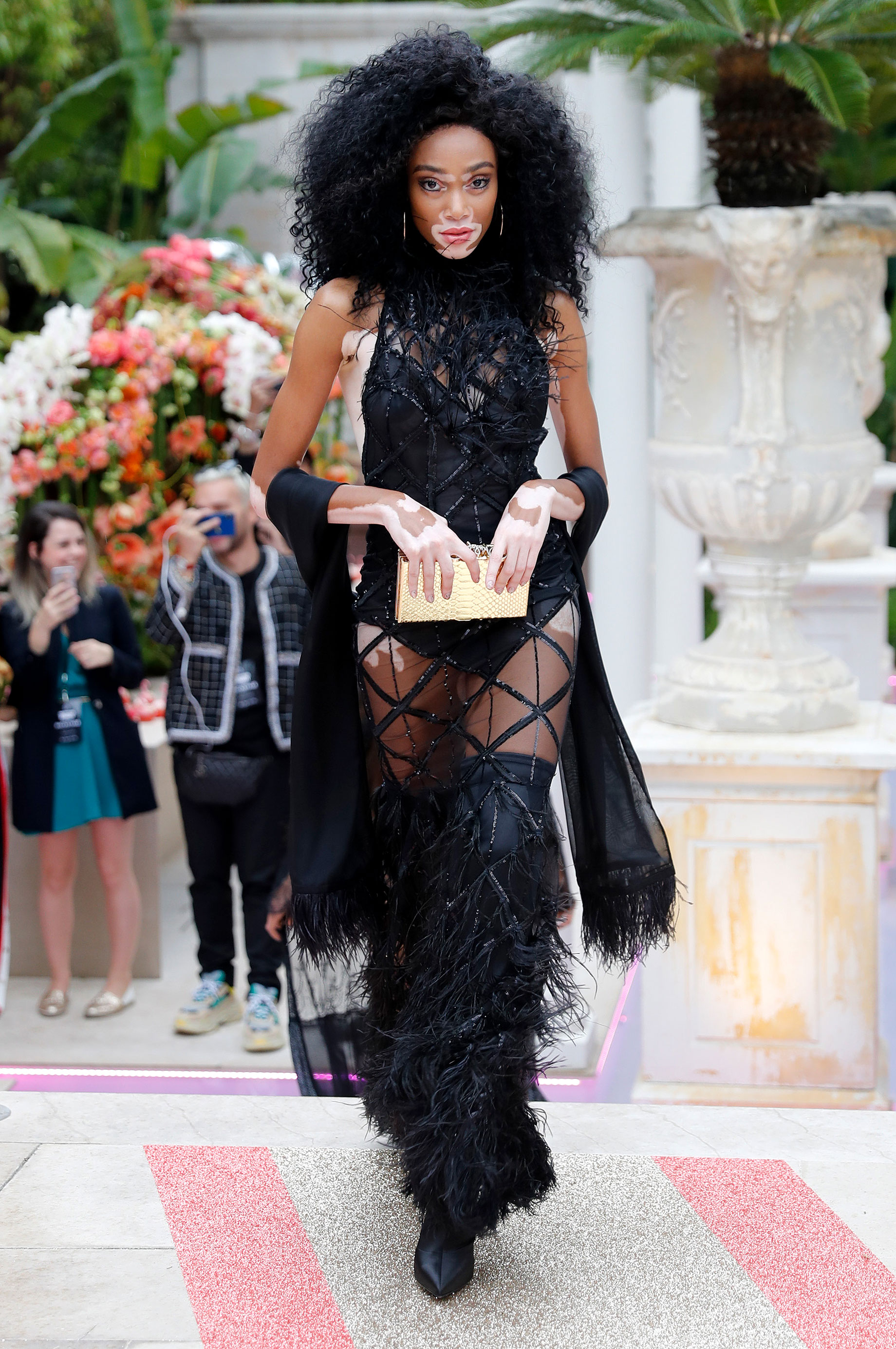 Winnie Harlow - The model strutted her stuff on the Philipp Plein catwalk on Wednesday, May 16 in a black lattice bodysuit and fringe thigh-high boots.