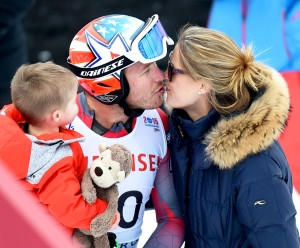 Bode Miller and his wife Morgan Beck while holding their child in the finish area after the 2015 World Alpine Ski Championships men's downhill training in Beaver Creek, Colorado.