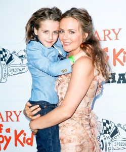 Alicia Silverstone and her son Bear appear at the 2017 premiere of Diary of a Wimpy Kid The Long Haul at the Indianapolis Motor Speedway in Indianapolis, Indiana.