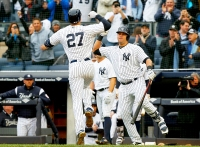 Giancarlo Stanton #27 of the New York Yankees celebrates his first inning two run home run against the Tampa Bay Rays with teammate Gary Sanchez #24 at Yankee Stadium on April 4, 2018 in the Bronx borough of New York City.