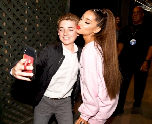 Ryan McKenna and Ariana Grande pose for a selfie photo backstage at the 2018 iHeartRadio Wango Tango by AT&T at Banc of California Stadium on June 2, 2018 in Los Angeles, California.