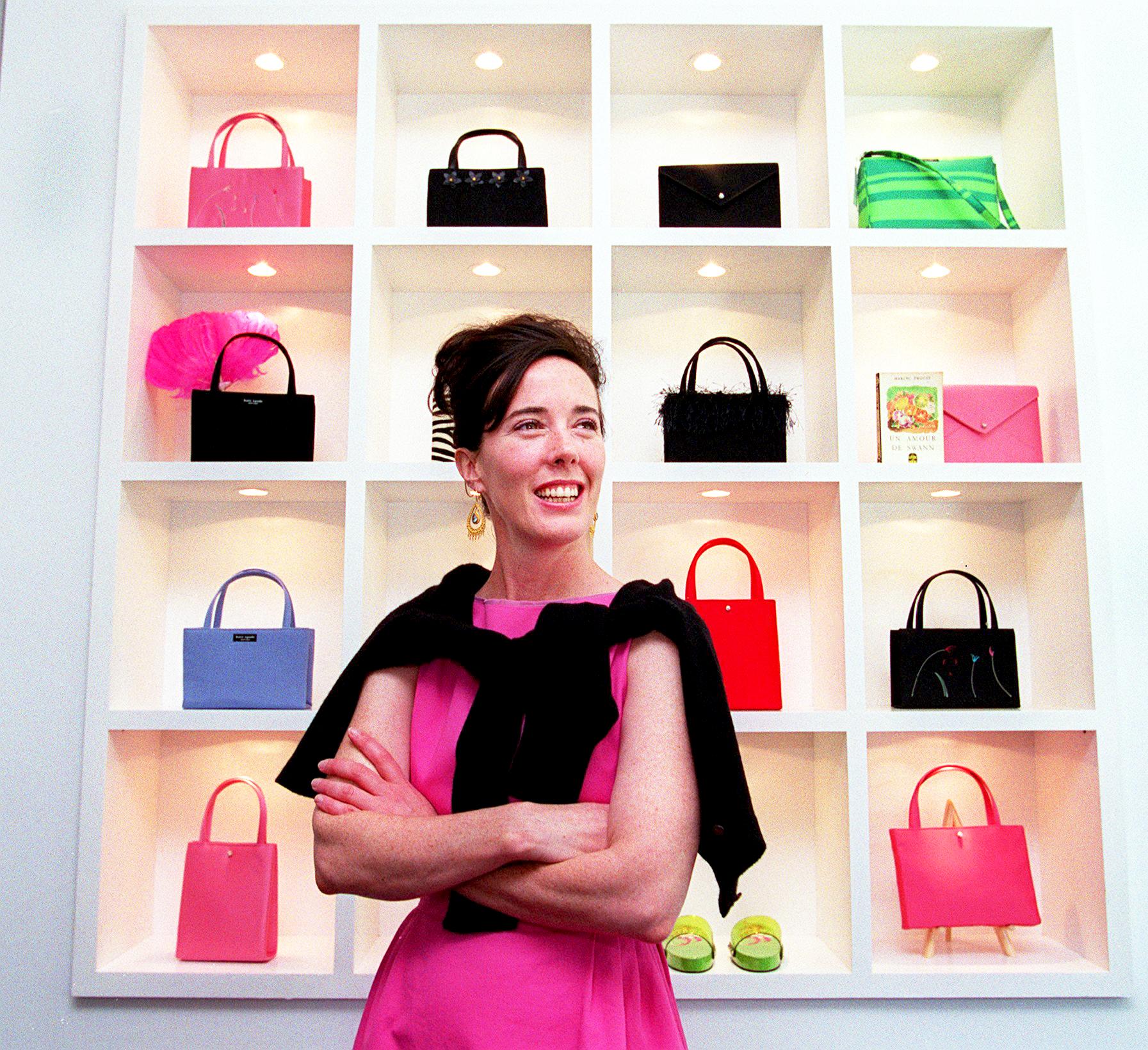 Kate Spade poses in her handbag store on Newbury Street in Boston.