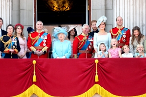 Princess Anne, Princess Royal, Princess Beatrice, Lady Louise Windsor, Prince Andrew, Duke of York, Queen Elizabeth II, Meghan, Duchess of Sussex, Prince Charles, Prince of Wales, Prince Harry, Duke of Sussex, Catherine, Duchess of Cambridge, Prince William, Duke of Cambridge, Princess Charlotte of Cambridge, Savannah Phillips, Prince George of Cambridge and Isla Phillips watch the flypast on the balcony of Buckingham Palace during Trooping The Colour on June 9, 2018 in London, England.