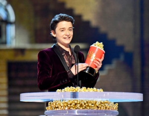 Noah Schnapp accepts award onstage at the 2018 MTV Movie And TV Awards at Barker Hangar on June 16, 2018 in Santa Monica, California.