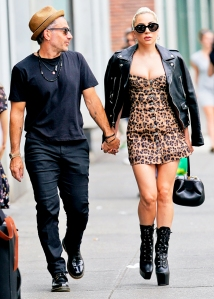 Lady Gaga and Christian Carino walk to her studio on June 28, 2018 in New York City.
