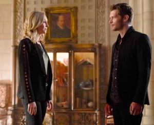 Candice King as Caroline and Joseph Morgan as Klaus on The Originals