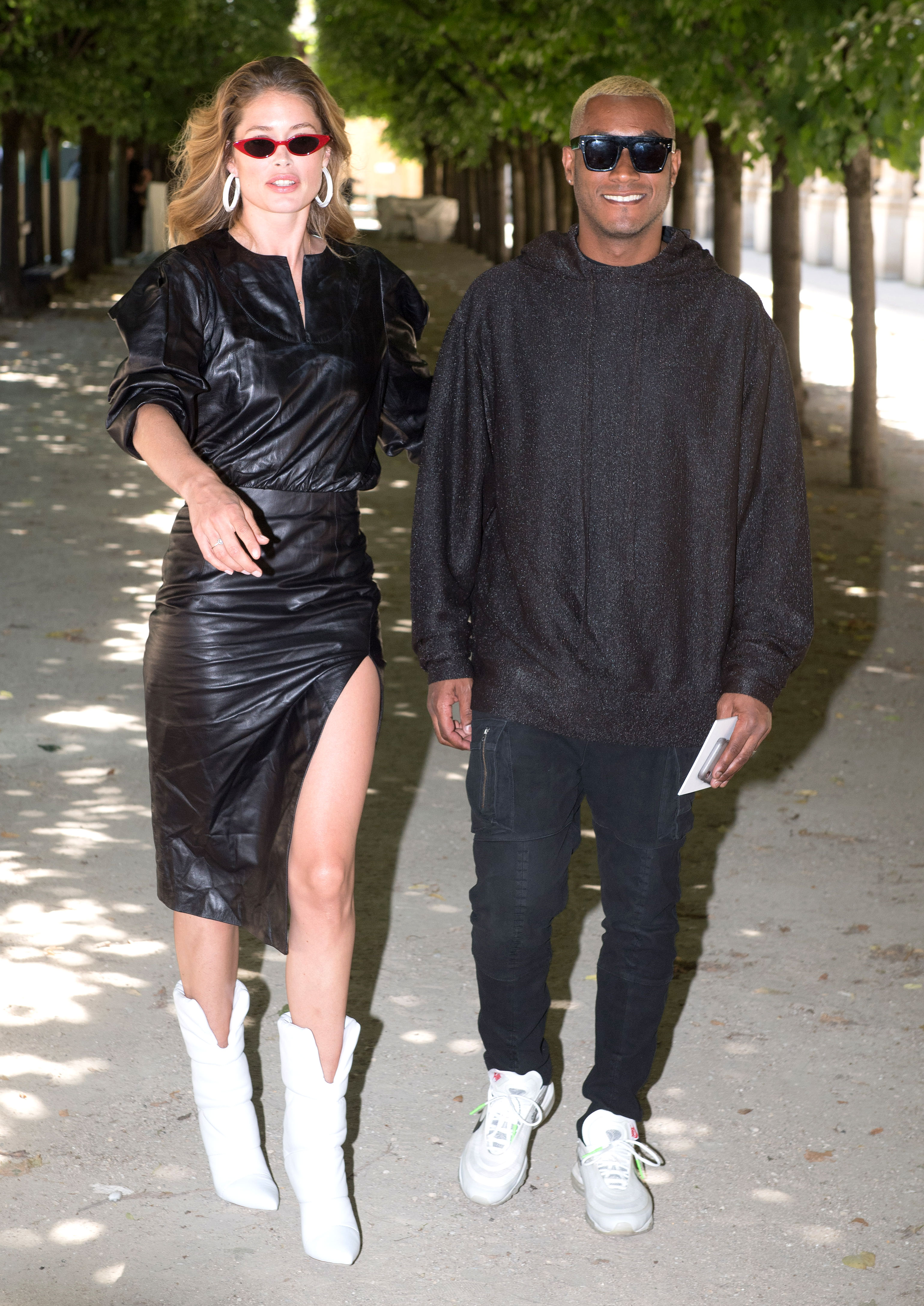 Doutzen Kroes and husband Sunnery James - The couple that color coordinates together, stays together. Or at least that's our take on the supermodel's black leather midi and white boot look at the Louis Vuitton show on Thursday, June 21, that pairs perfectly with her hubby's black sweat sweatshirt, jeans and white sneakers.