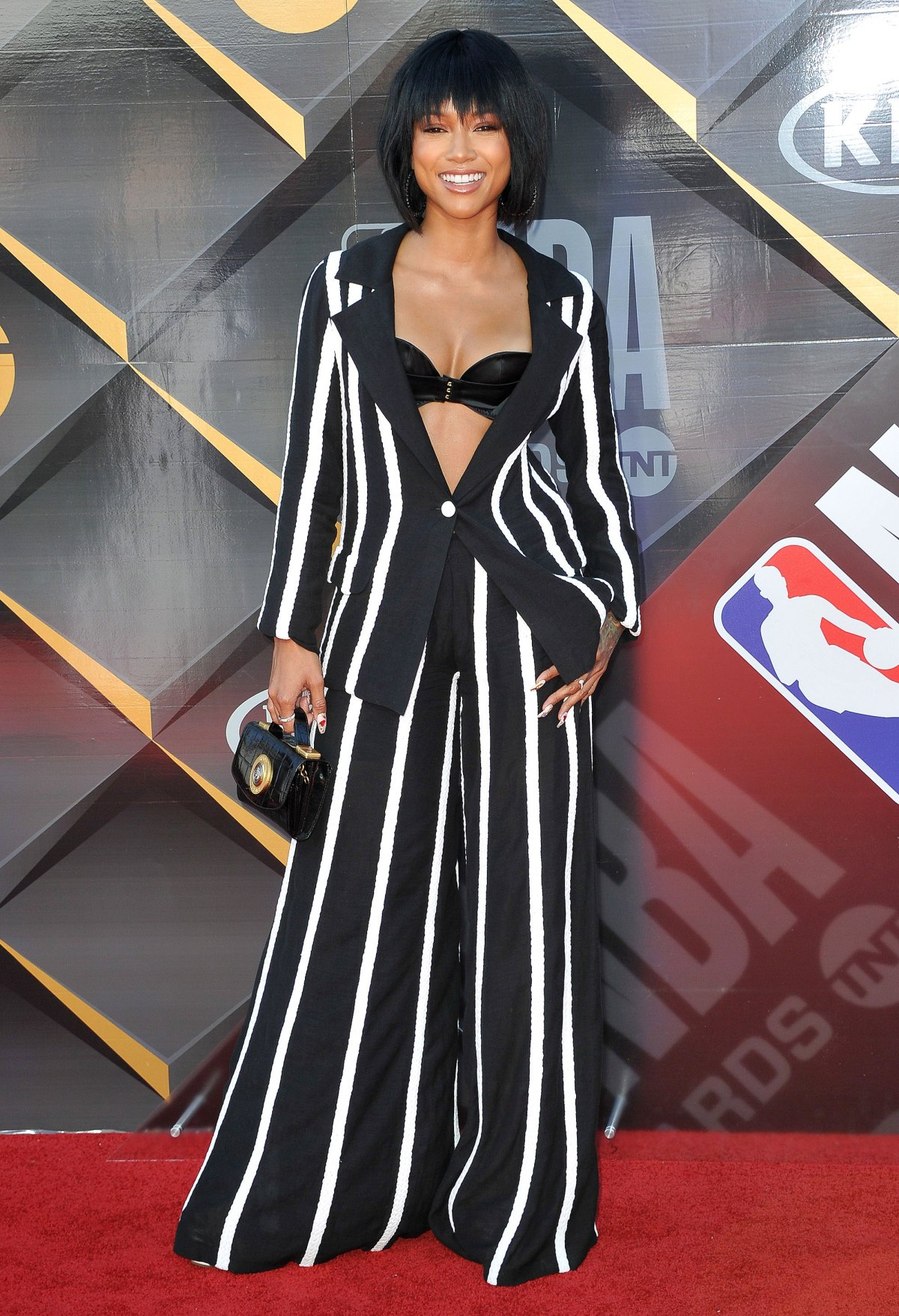 2a317e6baac8 See Which Female Stars Traded In Their Red Carpet Dresses For Suits