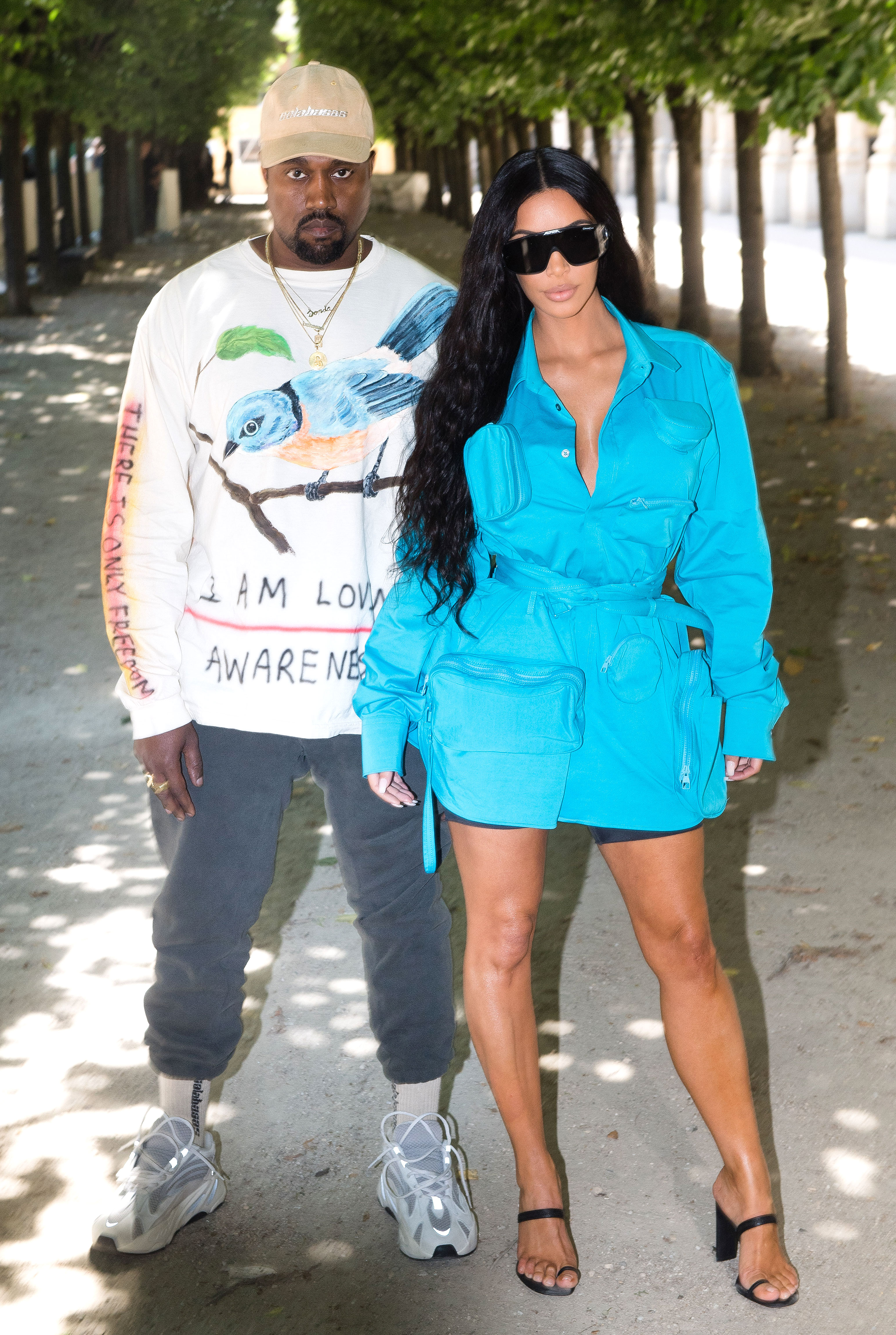 Kanye West and Kim Kardashian - PARIS, FRANCE – JUNE 21: Kanye West and Kim Kardashian attends the Louis Vuitton Menswear Spring/Summer 2019 show as part of Paris Fashion Week Week on June 21, 2018 in Paris, France. (Photo by Stephane Cardinale – Corbis/Corbis via Getty Images)