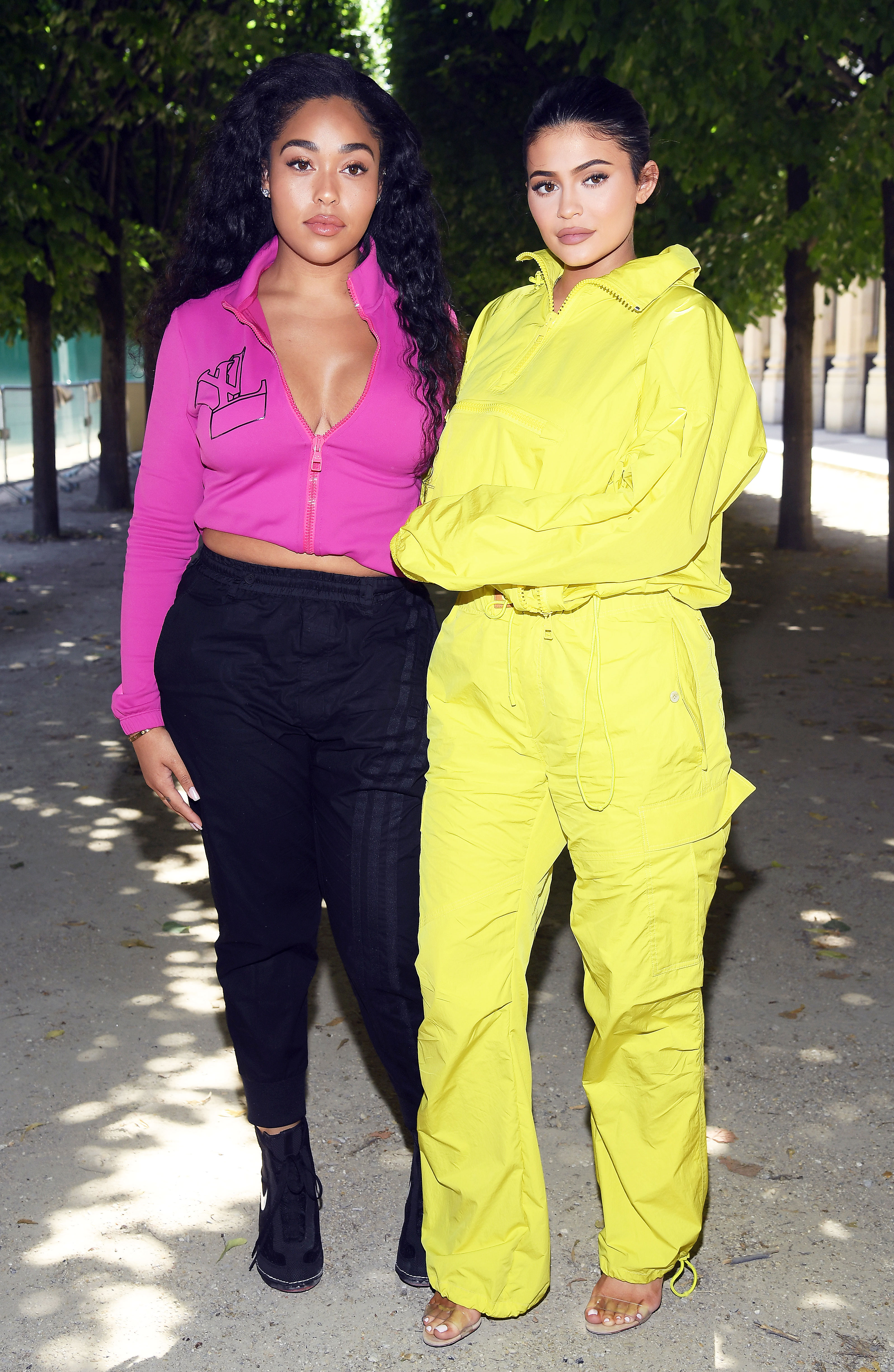 Jordyn Woods and Kylie Jenner - After hanging out at the 2018 Cannes Lions Festival to watch Travis Scott perform, the besties headed to Paris for Louis Vuitton on Thursday, June 21, in their athleisure best. Jordyn rocked a hot pink monogrammed zip-up, while Kylie shined as bright as the sun in a lemon yellow one piece.