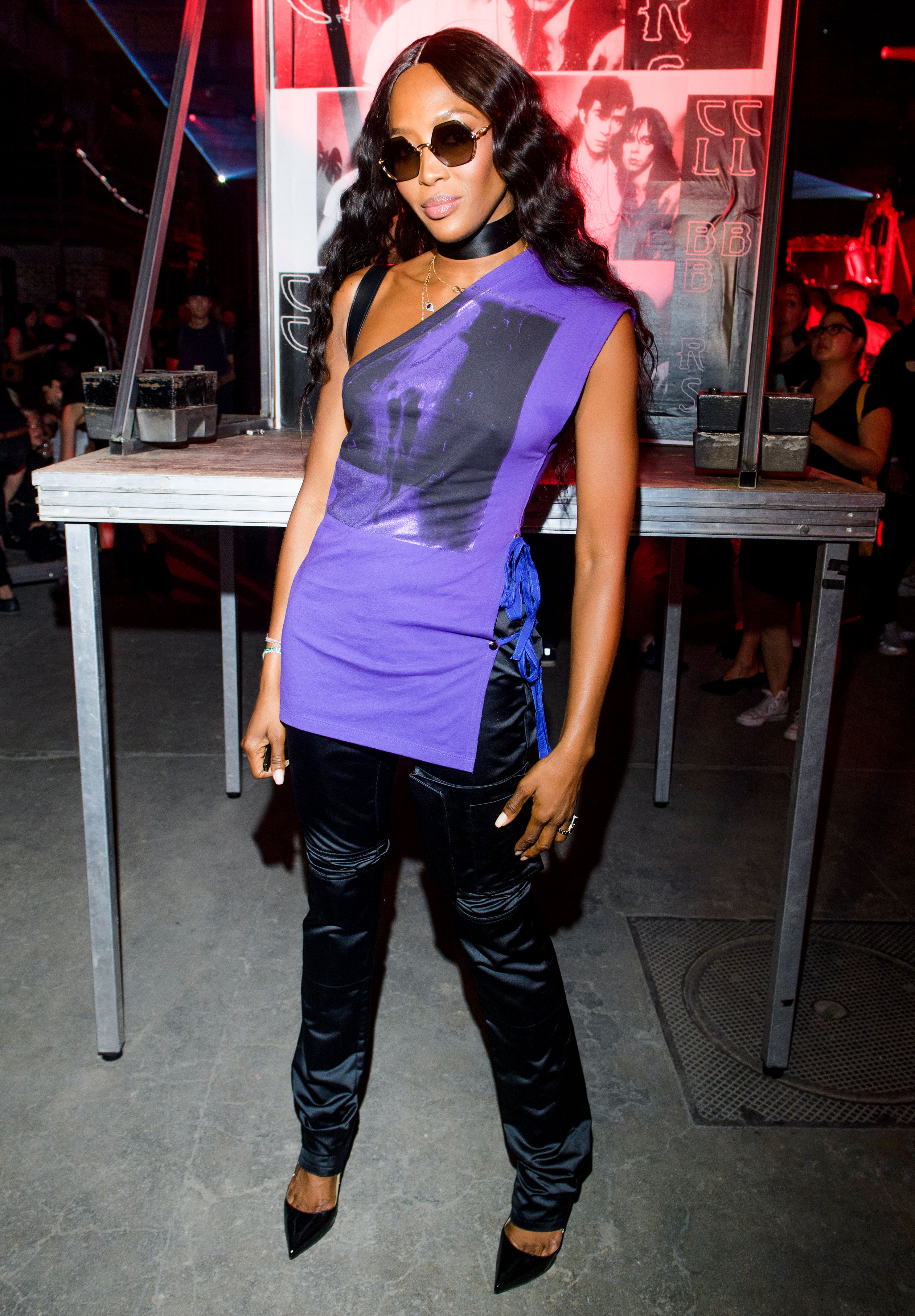 Naomi Campbell - The OG supermodel looked cool in satin trousers and a purple one-shoulder tank at the Raf Simons show on Wednesday, June 20.