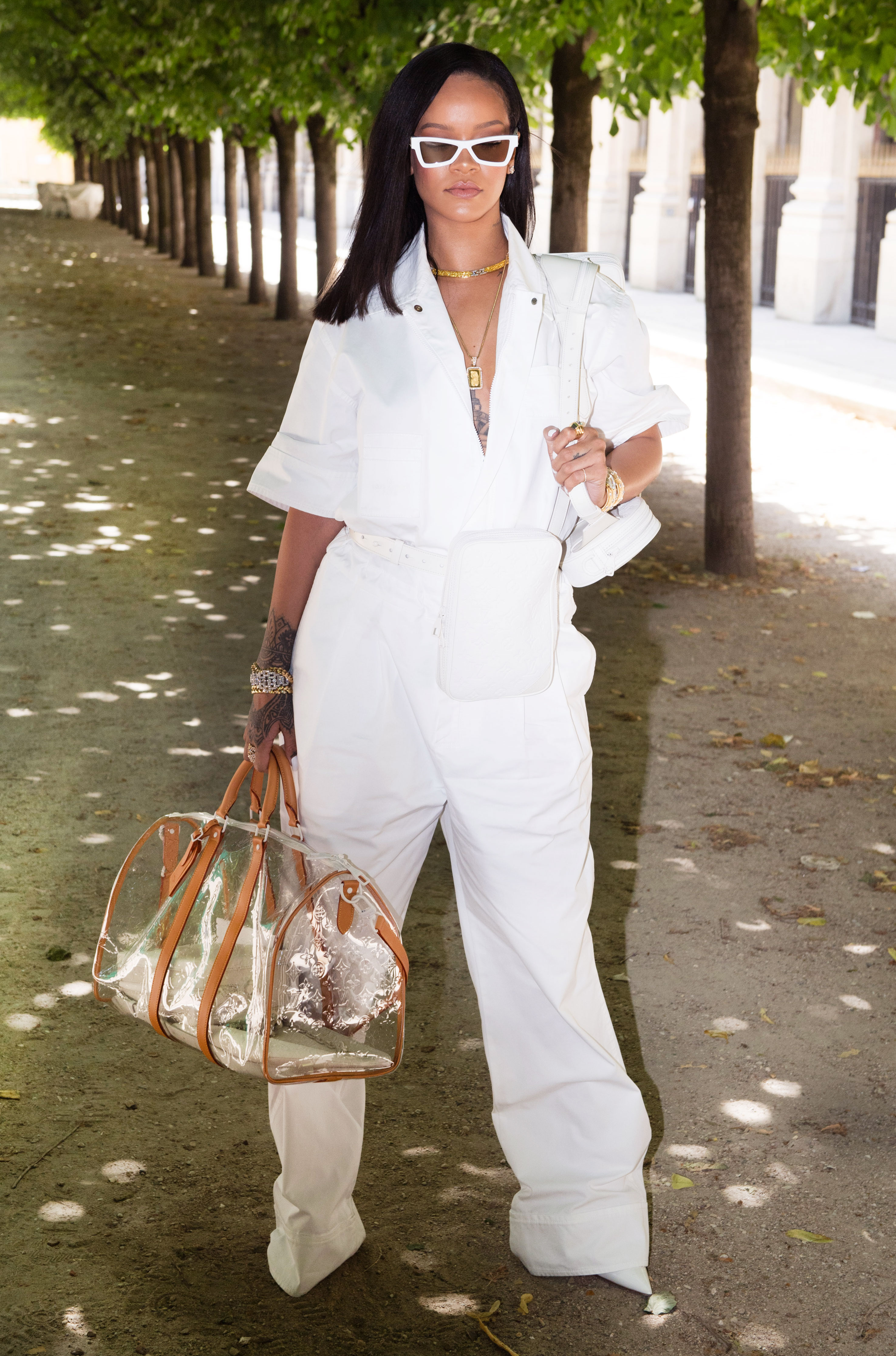Rihanna - Inspiring Us all to try a head-to-toe white ensemble, RiRi looked fierce in a pristine jumpsuit with matching bags, shoes and shades and Buccellati jewelry at the Louis Vuitton show on Thursday, June 21.