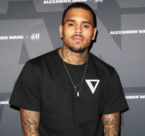 Chris Brown attends the 2014 Alexander Wang x H&M Pre-Shop Party at H&M in West Hollywood, California.