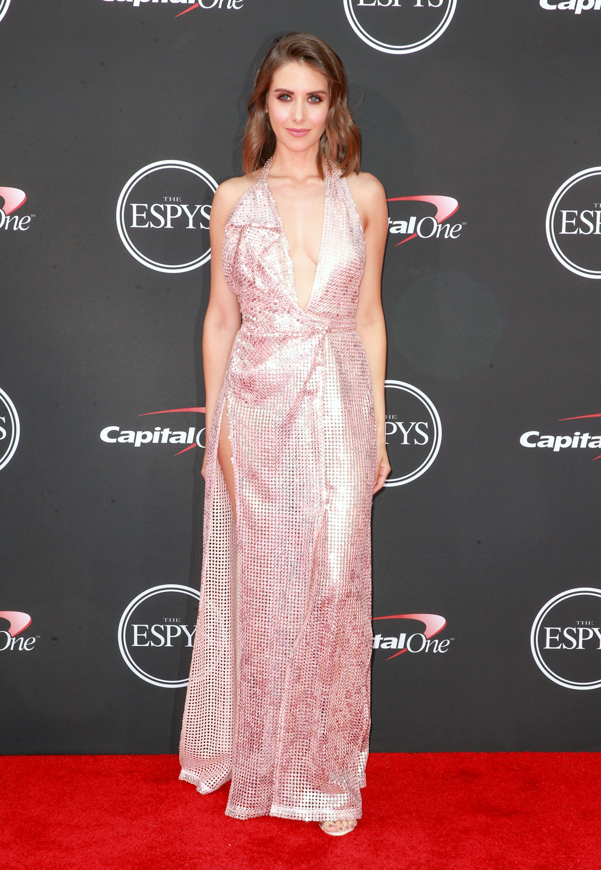 Alison Brie espys - Wearing a Vivienne Westwood Couture pink sequined dress with a plunging neckline and Sophia Webster gem sandals.