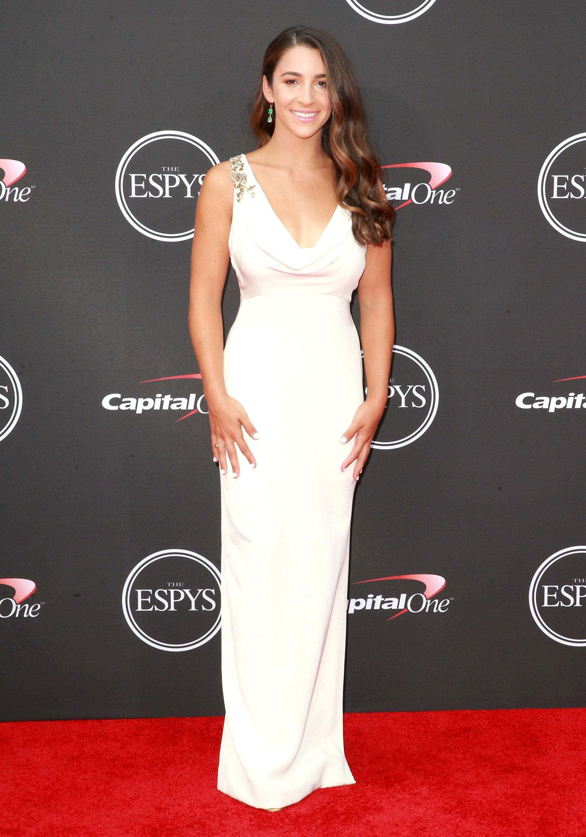 Aly-Raisman-espys - Wearing a white column gown with embellishment along the neckline.