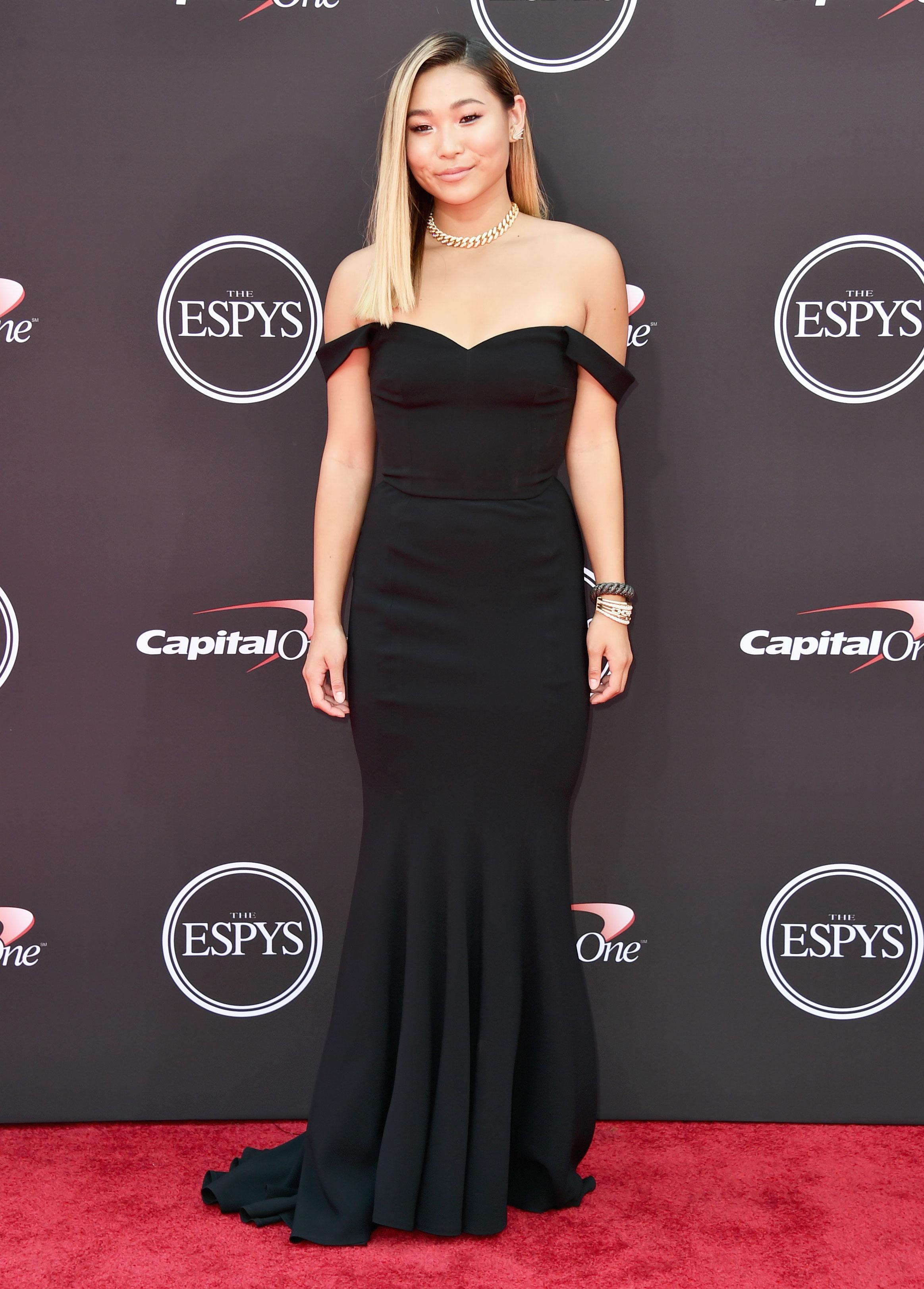 Chloe-Kim-espys - Wearing a black off-the-shoulder Dolce & Gabbana gown.
