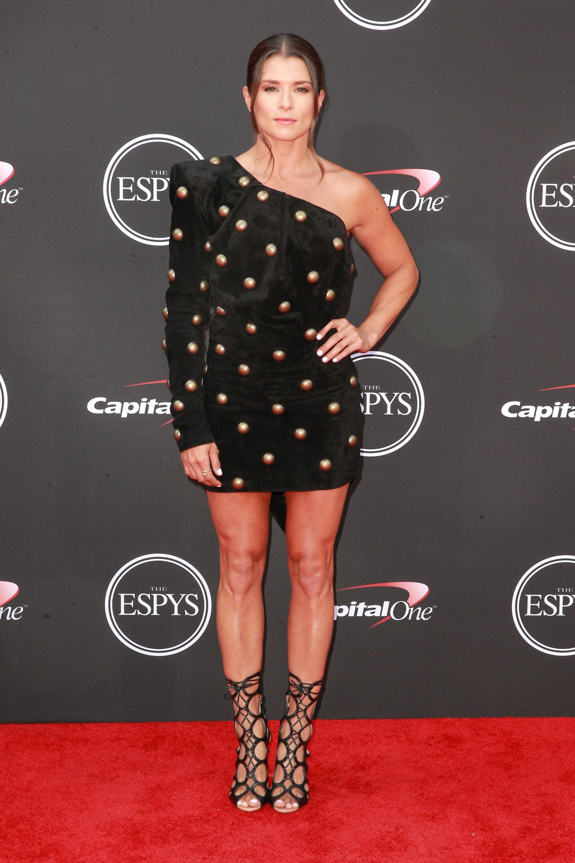 Danica-Patrick-espys - Wearing a studded Saint Laurent velvet one-shoulder mini and lace booties.