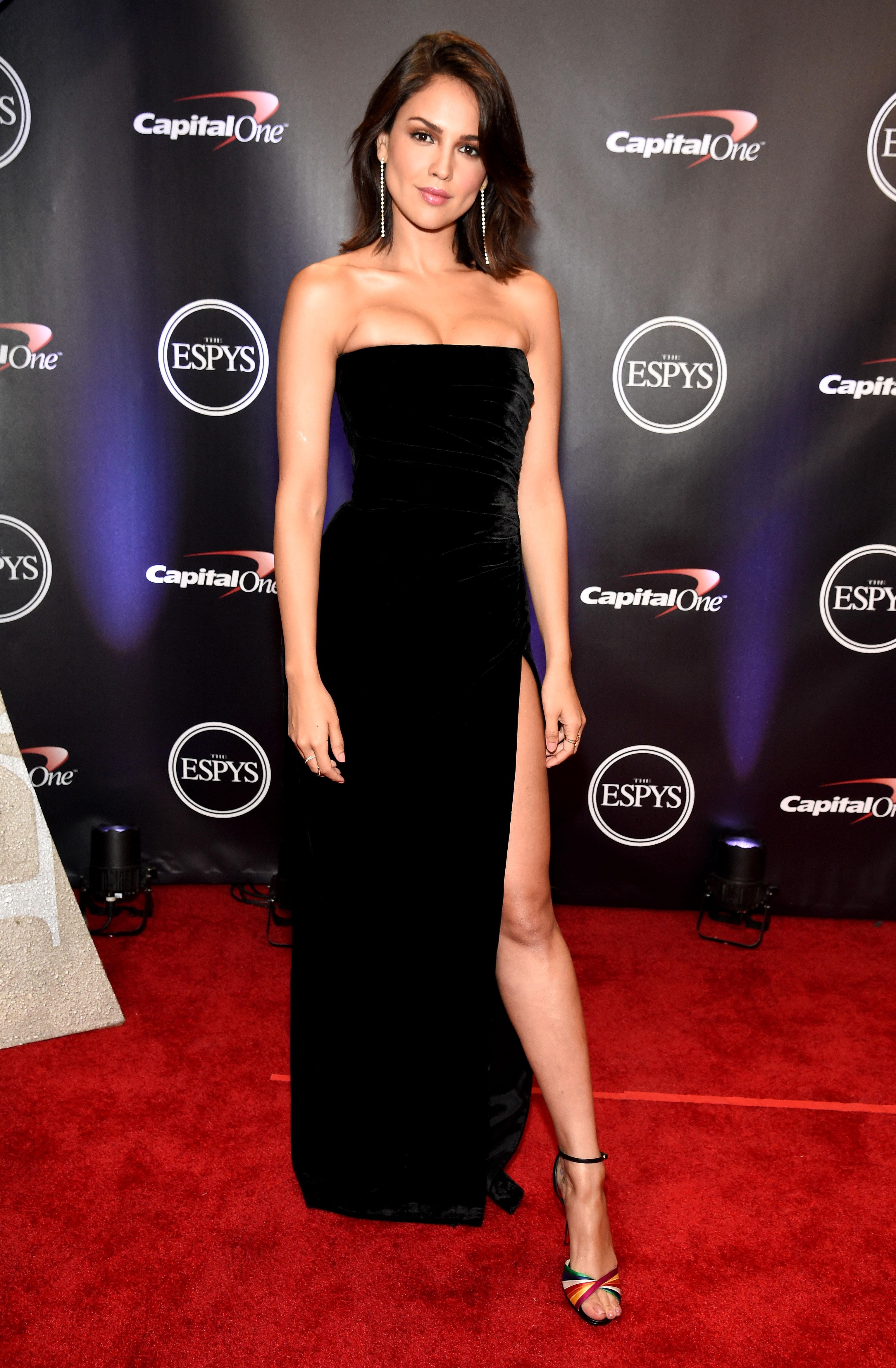 Eiza-Gonzalez-espys - Wearing a black velvet strapless Rasario gown, colorful sandals and Jennifer Meyer jewels.