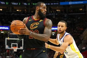 LeBron James #23 of the Cleveland Cavaliers defended by Stephen Curry #30 of the Golden State Warriors during Game Four of the 2018 NBA Finals at Quicken Loans Arena on June 8, 2018 in Cleveland, Ohio.