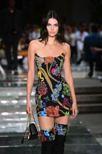 US model Kendall Jenner presents a creation by Versace during the men & women's spring/summer 2019 collection fashion show in Milan, on June 16, 2018. (Photo by MIGUEL MEDINA / AFP) (Photo credit should read MIGUEL MEDINA/AFP/Getty Images)