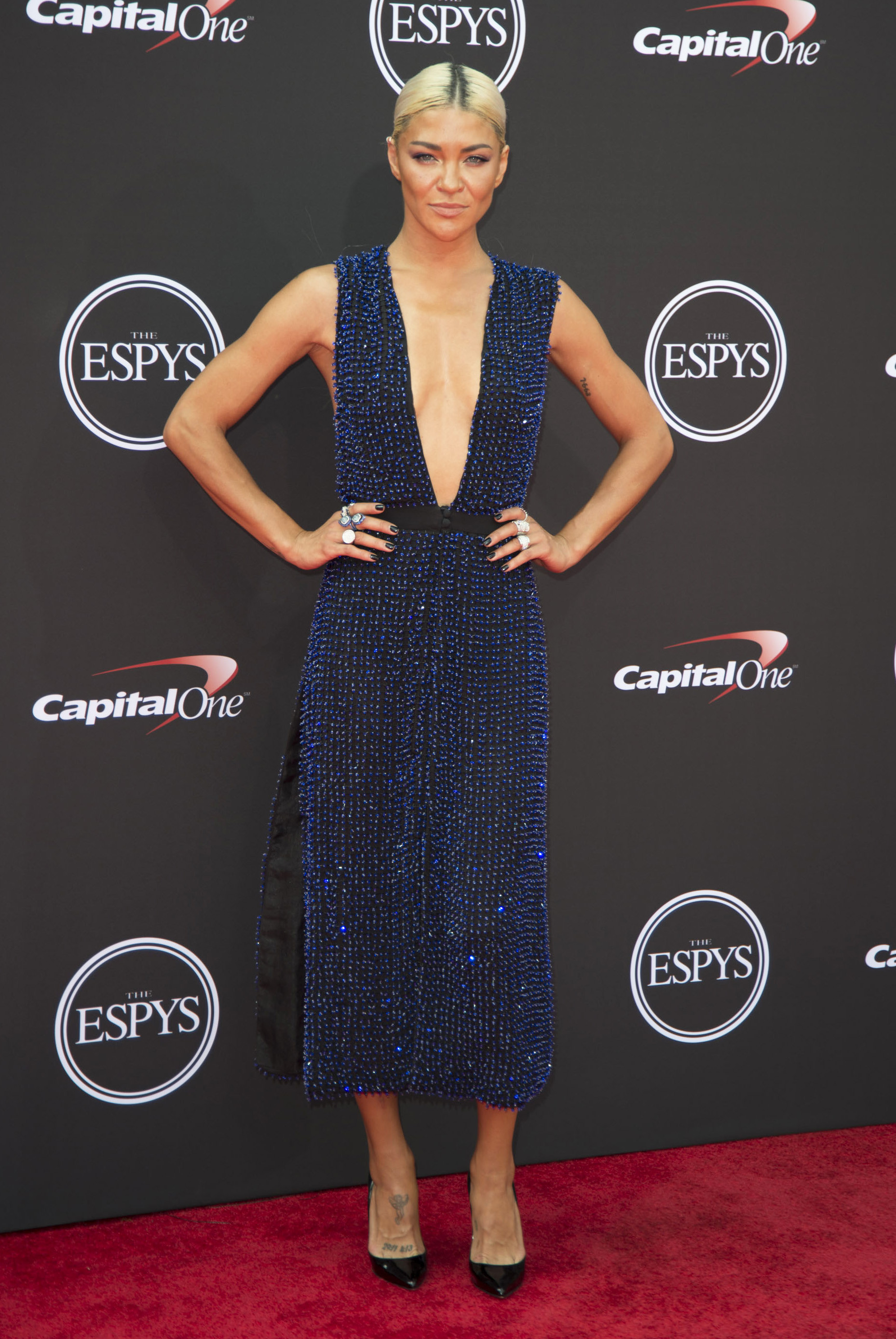 JESSICA SZOHR-espys - Wearing a navy beaded Steven Khalil mididress with a plunging neckline and waist-high slits.