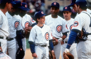 Thomas Ian Nicholas surrounded by teammates in a scene from the film 'Rookie Of The Year', 1993.