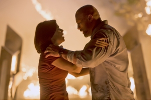 "Neve Campbell and Dwayne Johnson in ""Skyscraper"""