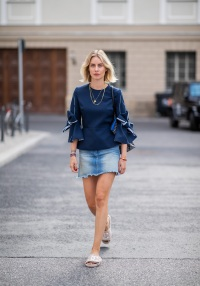 6be32b96c417 BERLIN, GERMANY - JULY 06: Lisa Hahnbueck wearing navy blue blouse with bow  sleeves Roksanda, denim mini skirt Frame, Chanel Terry Cloth Slides  slipper, ...