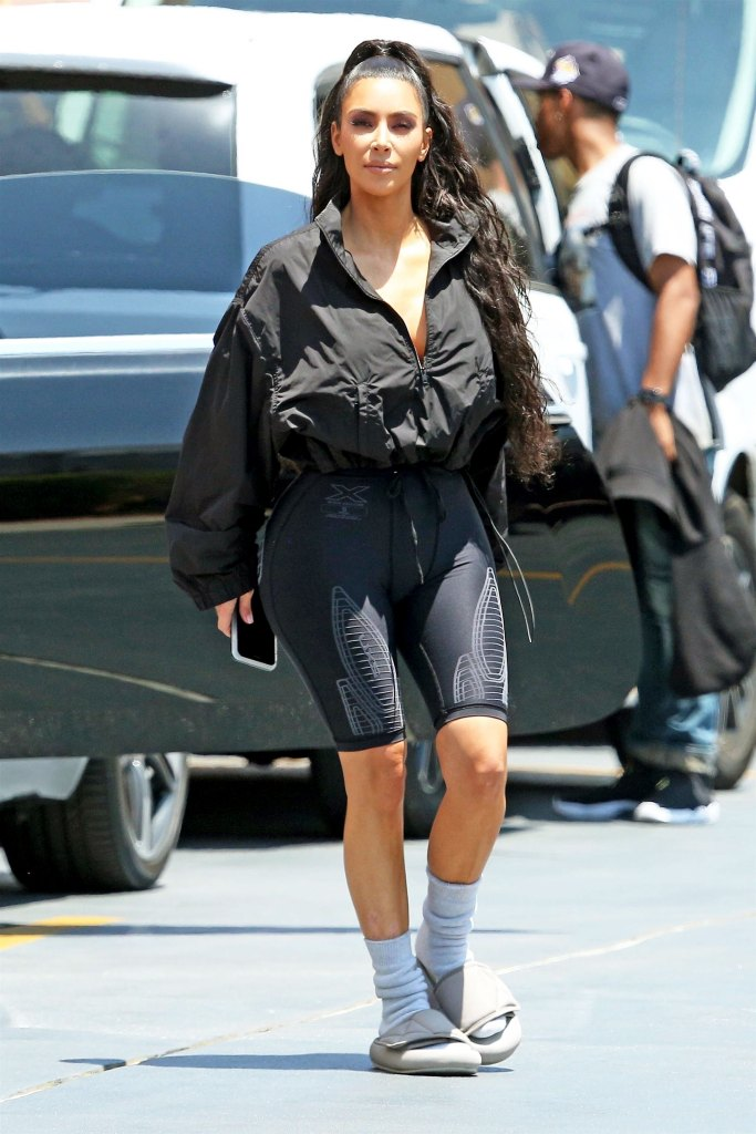 Kim Kardashian Wears Yeezy Slides With Socks Details