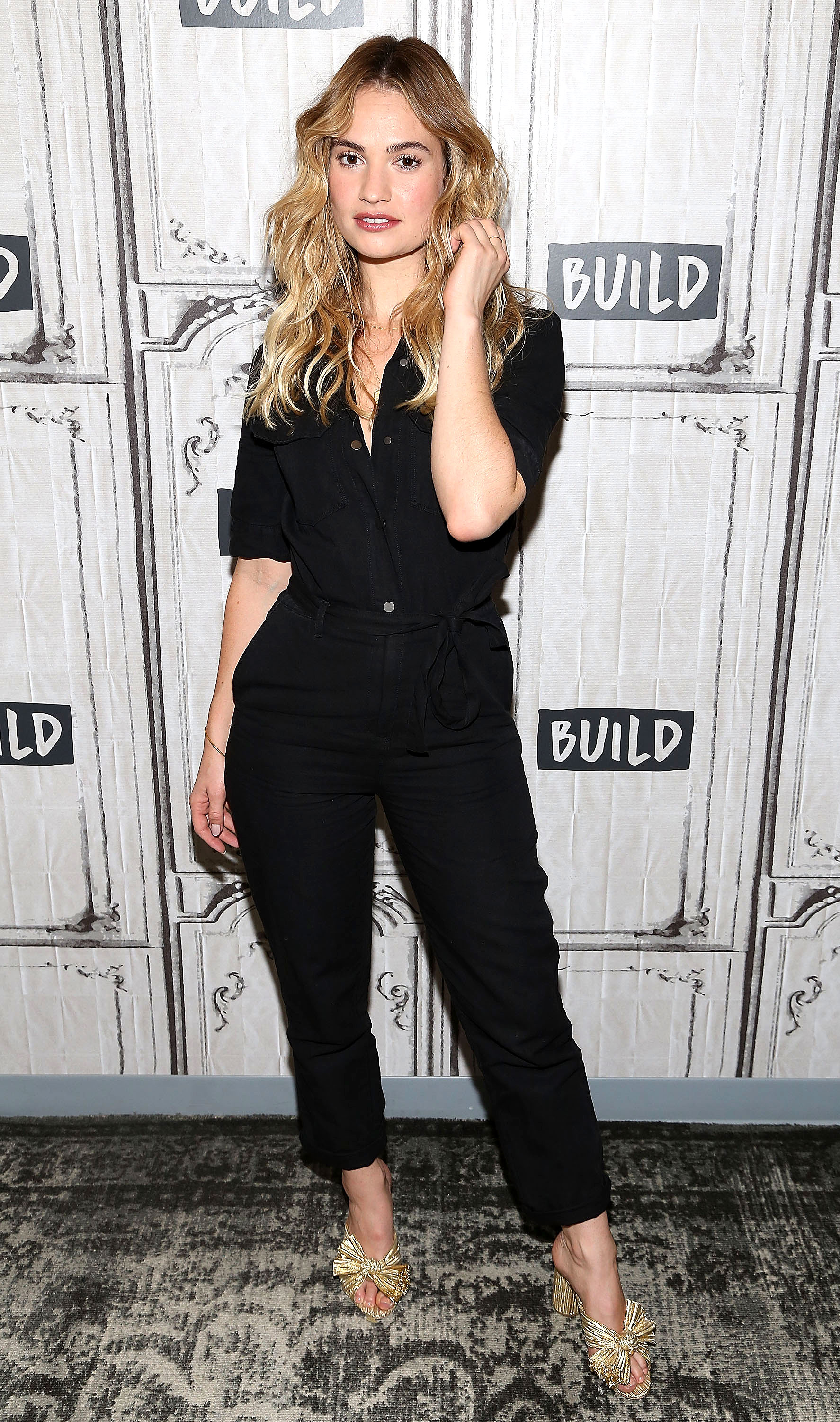 e488ca3911ed Lily James Is Utilitarian Chic in a Black Jumpsuit on ZIG