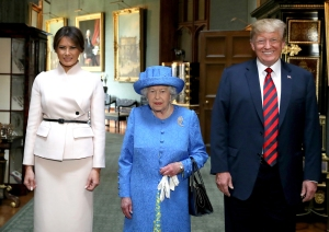 The Queen poses for a picture with US President Donald Trump and the First Lady, Melania Trump, in the Grand Corridor during their visit to Windsor Castle, Windsor.
