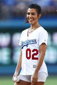 Kourtney Kardashian throws out the ceremonial first pitch prior to the MLB game at Dodger Stadium.