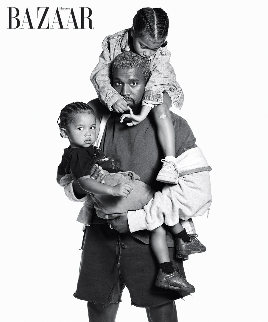 Kanye West holding North and Saint