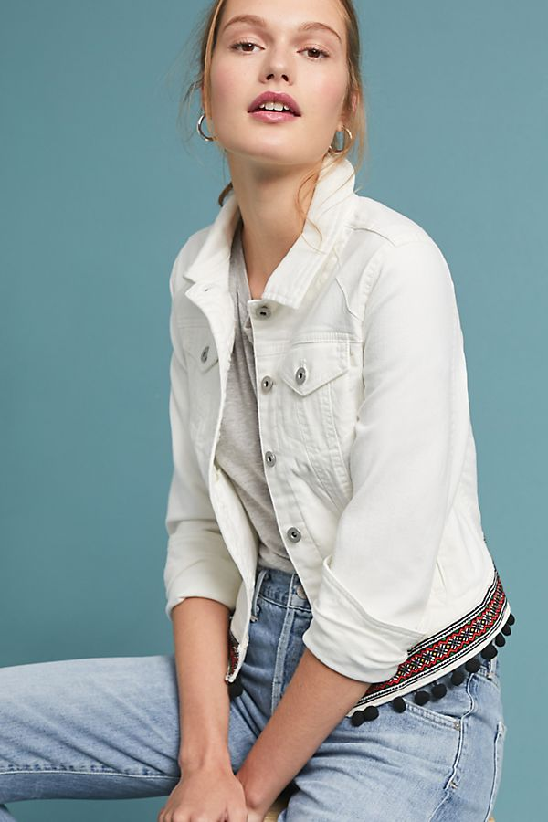white denim jacket with black tassels and embroidery