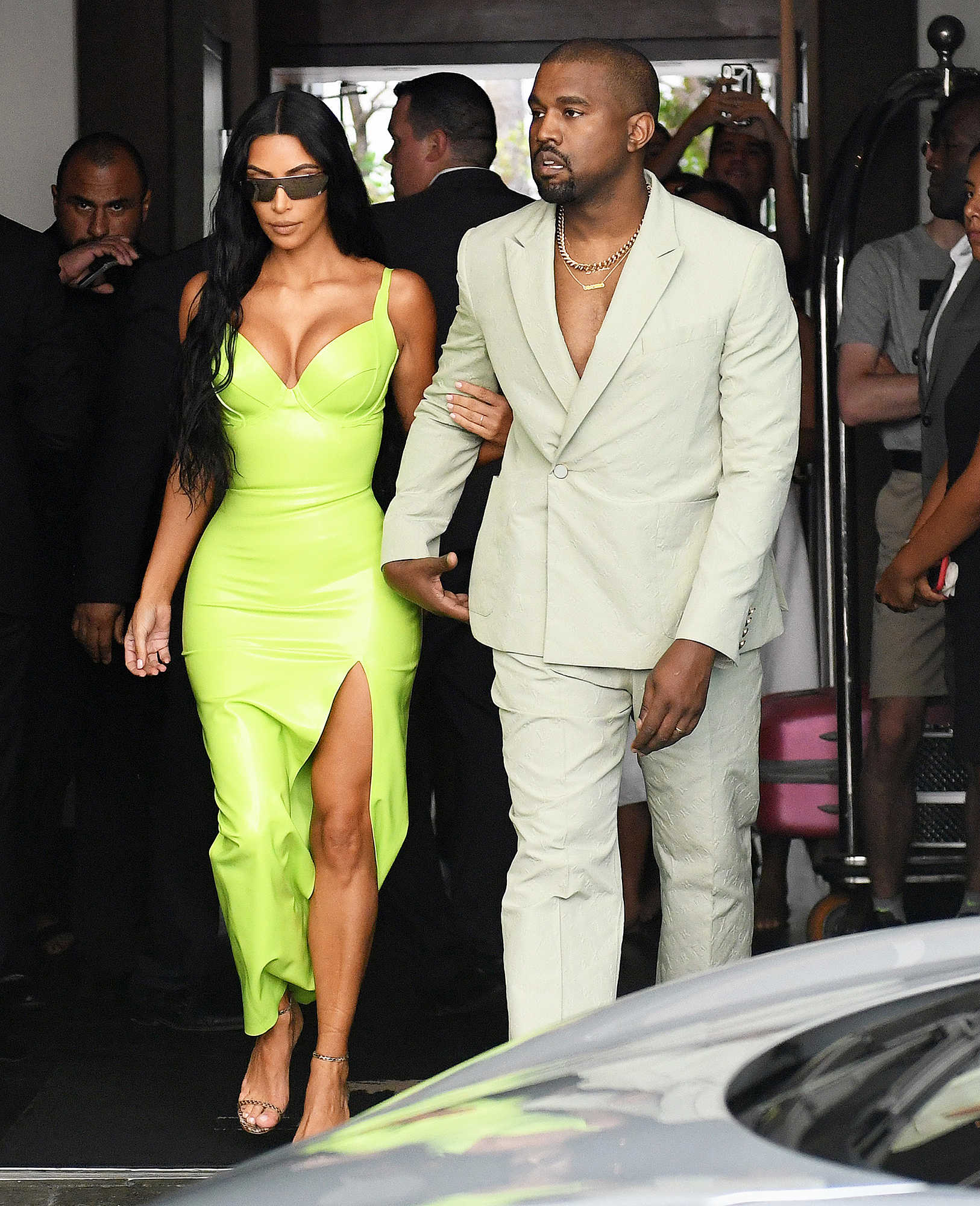 Kim Kardashian Kanye West 2 Chainz Wedding Ice Cream Date - The reality star held her husband's arm while leaving the ceremony.