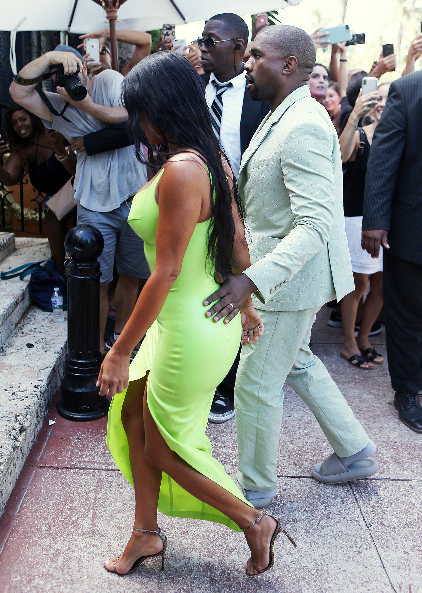 Kim Kardashian Kanye West 2 Chainz Wedding Ice Cream Date - West led Kardashian through the crowd with a sweet gesture, placing his hand at the small of her back.
